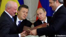Russia's President Vladimir Putin (R, back) and his Ukrainian counterpart Viktor Yanukovich (L, back) attend a signing ceremony after a meeting of the Russian-Ukrainian Interstate Commission at the Kremlin in Moscow in this December 17, 2013 file photo. To match Special Report UKRAINE-RUSSIA/DEAL REUTERS/Sergei Karpukhin/Files (RUSSIA - Tags: BUSINESS POLITICS)