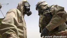 The Nobel Peace Prize 2013 awarded to chemicals weapons watchdog OPCW ( an organization for the prohibition of chemical weapons ) IRAQ WAR March, 21st, 2003 Check Point Kuwait-Iraq. American soldiers wearing a gas mask against Chemical Weapons American soldiers wear anti- Nbc mask soon after the alarm has started.