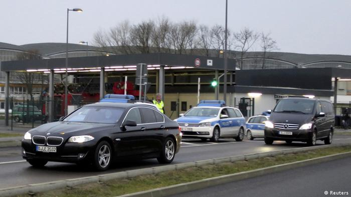 A convoy of cars which are belived to carry former oil tycoon Mikhail Khodorkovsky is escorted by German police as they leave the Schoenefeld airport in Berlin December 20, 2013. (Photo via REUTERS/Fabrizio Bensch)