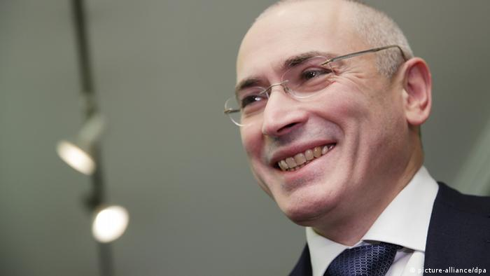Khodorkovsky in Berlin, smiling and suited.