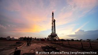 An oil refinery in Juba seen against an evening sky