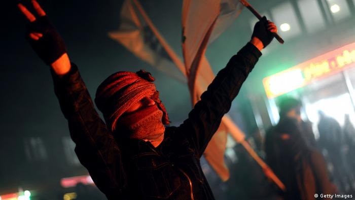 Young man protests against corruption in Turkey