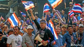 Anti-government protesters participate in a rally at the Dindang police station, near the Thai-Japan Youth Stadium in Bangkok December 23, 2013. The Thai baht plumbed its lowest level in almost four years on Monday as a political crisis grew more intractable, with anti-government protesters attempting to stop candidates from registering for a February election. (Photo: REUTERS/Athit Perawongmetha)