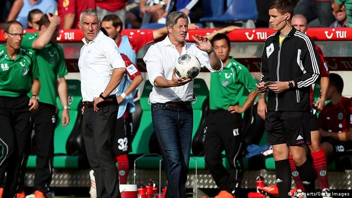 Coaches Mirko Slomka and Jens Keller stand side-by-side (with keller holding the ball) during Hannover 96's 2-1 home win over Schalke, August 24, 2013. (Photo via Ronny Hartmann/Bongarts/Getty Images)