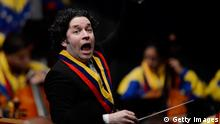 Gustavo Dudamel conducts the Simon Bolivar Symphony Orchestra during the ministers swearing-in ceremony in Caracas on April 22, 2013. AFP PHOTO/Leo Ramirez (Photo credit should read LEO RAMIREZ/AFP/Getty Images)