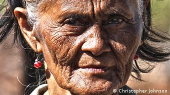A close-up picture of an old woman called Mama Nessing, whose house was destroyed by the typhoon
