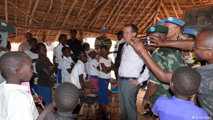 Martin Kobler surrounded by children at a school
