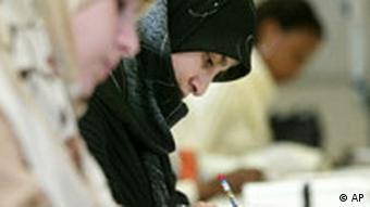 Young Muslim girls sit in a German classroom