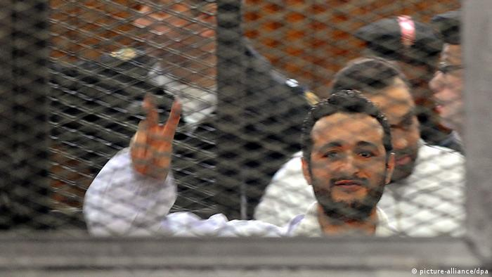 A picture of activist Ahmed Douma behind bars during his trial in 2013.