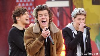 Louis Tomlinson, Harry Styles and Niall Horan of One Direction at a performance on November 26, 2013