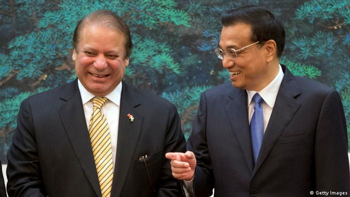 Pakistan Prime Minister Nawaz Sharif (L) chats with Chinese Premier Li Keqiang (R) before a signing ceremony held at the Great Hall of the People on July 5, 2013 in Beijing, China, Friday (Photo: Ng Han Guan - Pool via Getty Images)