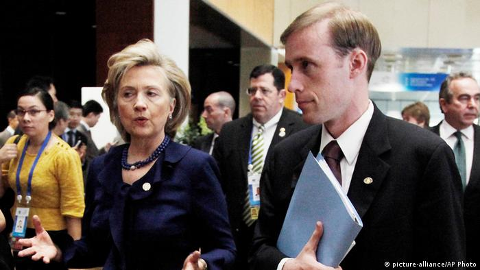 Jake Sullivan standing next to Hillary Clinton in 2009