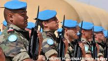 French Soldiers from the 517éme Régiment du Train de Chateauroux (France) on March 15, 2009 receive their blue UN peacekeeping berets in the eastern Chadian town of Abeche in a symbolic handover ceremony attended by senior officials and diplomats, including French Foreign Minister Bernard Kouchner. Some 5,200 peacekeepers from the UN's MINURCAT mission are now charged with protecting refugees from Sudan's strife-torn Darfur region and people displaced by a rebel insurgency in Chad and northern Central African Republic, though roughly 2,000 members of the European force will remain for a few more months under the UN beret until African and Nepalese units arrive. AFP PHOTO / PHILIPPE HUGUEN (Photo credit should read PHILIPPE HUGUEN/AFP/Getty Images)