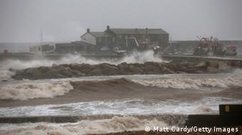 Storm waves break on the sea wall in front of the Cobb on December 23, 2013 in Lyme Regis, England.