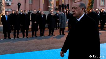 Erdogan walks past his ministers (rear L-R) European Affairs Minister Egemen Bagis, Economy Minister Zafer Caglayan, Energy Minister Taner Yildiz, Agriculture Minister Mehdi Eker, Interior Minister Muammer Guler and Education Minister Nabi Avci during a ceremony (photo: REUTERS/Umit Bektas)