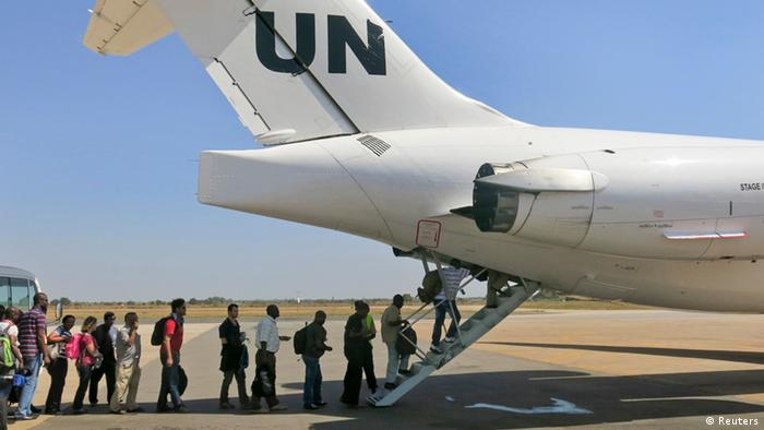 People boarding a UN plane