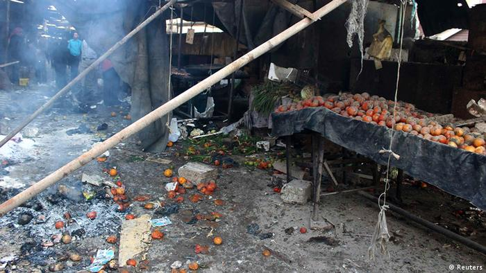 The charred black remains of a bombed-our market