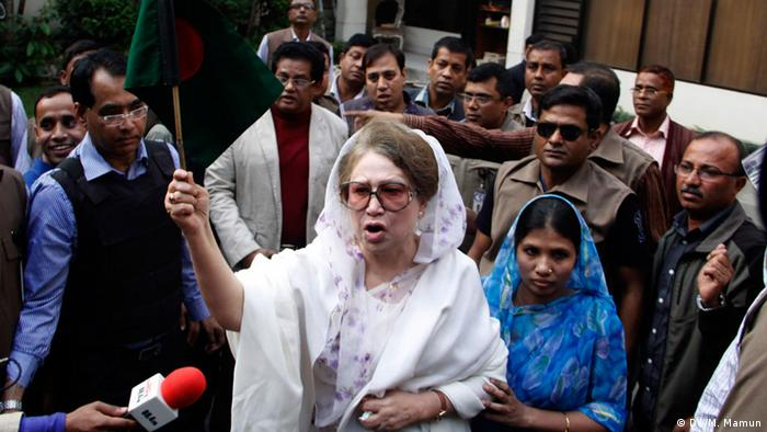 Khaleda Zia stands in a crowd of people