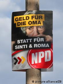 An NPD poster stapled to a pole (C) picture-alliance/ZB