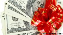 #59547808 - Dollar bills with red bow isolated on white © Africa Studio