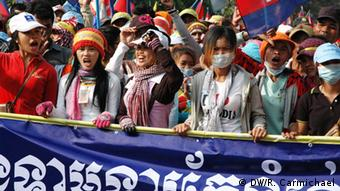 Garment workers joined tens of thousands of protesters marching through Phnom Penh on Sunday, calling for PM Hun Sen to quit and for the minimum wage to be boosted to $160.