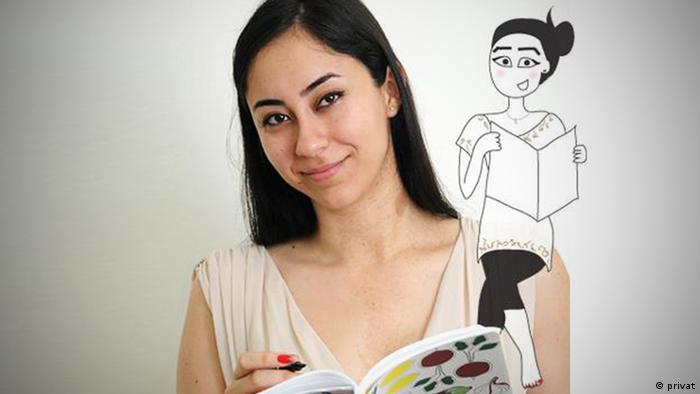 The Lebanese graphic designer Maya Zankoul poses with a book and pen in her hand