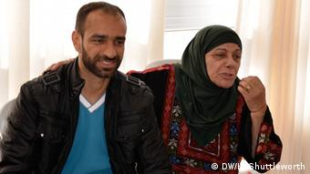 Samer Issawi with his mother in their family home in Issawiya in East Jerusalem