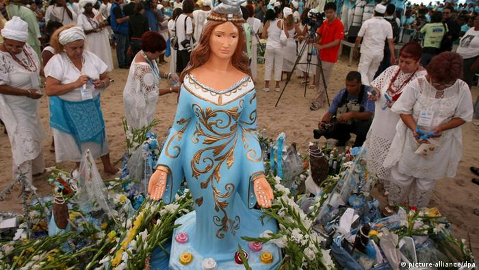 Believers put offerings near the image of Yemanja, the queen of the sea, during a commemoration at Copacabana beach, Rio de Janeiro, Brazil, 29 December 2008.
