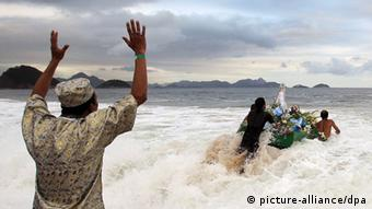Believers send offerings out to sea to honor goddess Yemanja