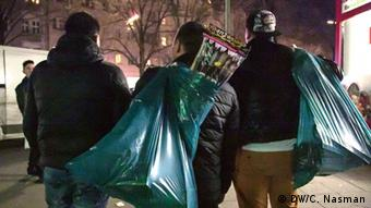 Men carrying bags of firecrackers