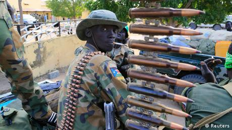 South Sudanese soldier with machine gun