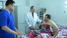 Russia's President Vladimir Putin (C) shakes hands with a man injured by one of two recent bombing at a local hospital in Volgograd January 1, 2014. Putin on Tuesday vowed to annihilate all terrorists following two deadly bomb attacks in the southern Russian city of Volgograd that raised security fears ahead of the Winter Olympics. The uncompromising remarks in a televised New Year address were Putin's first public comments since suicide bombers killed at least 34 people in attacks less than 24 hours apart on a railway station and the trolleybus on Sunday and Monday. REUTERS/Alexei Nikolskiy/RIA Novosti/Kremlin (RUSSIA - Tags: POLITICS CRIME LAW DISASTER TRANSPORT) ATTENTION EDITORS - THIS IMAGE HAS BEEN SUPPLIED BY A THIRD PARTY. IT IS DISTRIBUTED, EXACTLY AS RECEIVED BY REUTERS, AS A SERVICE TO CLIENTS
