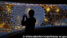 A visitor takes a snapshot with his smartphone to some of the 3200 pieces of gold exhibited at the Offerings Room inside the Gold Museum in Bogota, Colombia, on November 01, 2012. The Gold Museum's permanent exhibition shows the history of how gold and other metals were used by the pre-Hispanic societies who lived in the land today known as Colombia before contact was made with Europe. AFP PHOTO/Eitan Abramovich (Photo credit should read EITAN ABRAMOVICH/AFP/Getty Images)