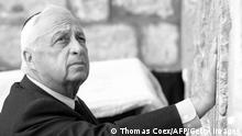 Israeli Prime Minister-elect Ariel Sharon places his hand on the Western Wall, Judaism's holiest site, in the Old City of Jerusalem 07 February 2001. It was Sharon's first public appearance the day after his landslide 25-point election win over incumbent premier Ehud Barak , who made the same visit the day after he defeated Benjamin Netanyahu just 21 months ago . AFP PHOTO/Thomas COEX (Photo credit should read THOMAS COEX/AFP/Getty Images)