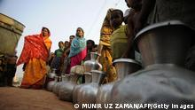 Bangladesh residents queue to collect water from a tanker in Dhaka on March 21, 2009 in an area which has been experiencing an acute water crisis for more than a month. Power cuts are causing severe water shortages in Dhaka, adding to the sufferings of millions of residents. World Water Day is observed on March 22 to raise awareness of the world water crisis and the goal of reducing by half the percentage of people who lack access to safe clean drinking water and basic sanitation. AFP PHOTO/Munir uz ZAMAN (Photo credit should read MUNIR UZ ZAMAN/AFP/Getty Images)