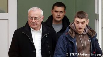Josip Perkovic, left, during his arrest in Croatia earlier this year Photo: STR/AFP/Getty Images