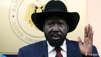 South Sudan's President Kiir wearing his trademark black hat