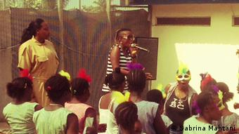 Hip-hop artist Star Zee performing Nar Yu Right in a female prison in Freetown.
