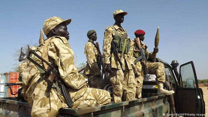 South Sudan army soldiers are standing in the back of a pickup truck. Photo: SAMIR BOL/AFP/Getty Images