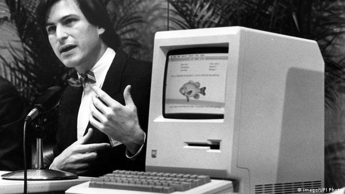 Steve Jobs is seen announcing the Apple Macintosh computer at a shareholders meeting on January 24, 1984.