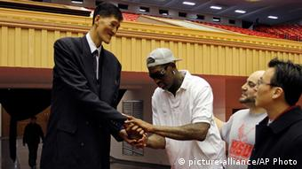 Dennis Rodman, center, meets with former North Korean basketball player Ri Myung Hun at a practice session with USA and North Korean players in Pyongyang, North Korea on Tuesday, Jan. 7, 2014. Rodman came to the North Korean capital with a squad of USA basketball stars for an exhibition game on Jan. 8, the birthday of North Korean leader Kim Jong Un. (AP Photo/Kim Kwang Hyon)