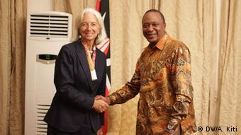 Christine Lagarde shakes hands with Lenyan president Uhuru Kenyatta