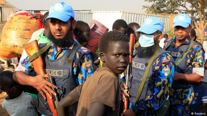 A scared Boy in front of three UN policemen from Bangladesh.