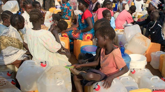 refugees wait for water at a UN camp in Juba