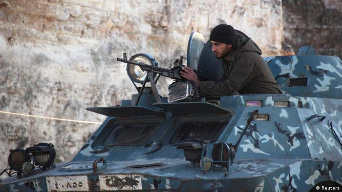 An ISIL fighter in an armored vehicle in the northwestern Syrian city of Maaret al-Naaman