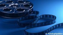 #49555474 - Film reel with filmstrip © Sashkin