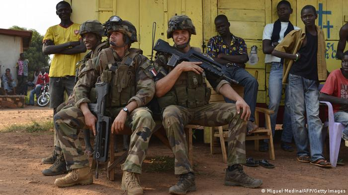 French soldiers from the Sangaris operation are taking a rest during a patrol in the Castor district of Bangui. Photo: MIGUEL MEDINA/AFP/Getty Images