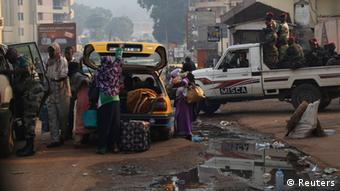 Chadian citizens embark with their belongings into a taxi outside the Chad embassy in Bangui to head towards the airport. Photo: REUTERS/Emmanuel Braun