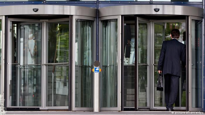 Two revolvig doors Photo: Daniel Karmann/dpa & Revolving door makes public service self serving | Europe | DW ... Pezcame.Com