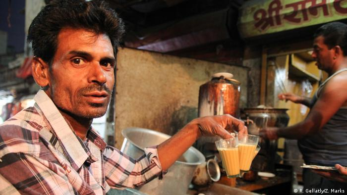 Mahinder serves chai to customers at Sri Ram Tea Stall, Jodhpur, Rajasthan